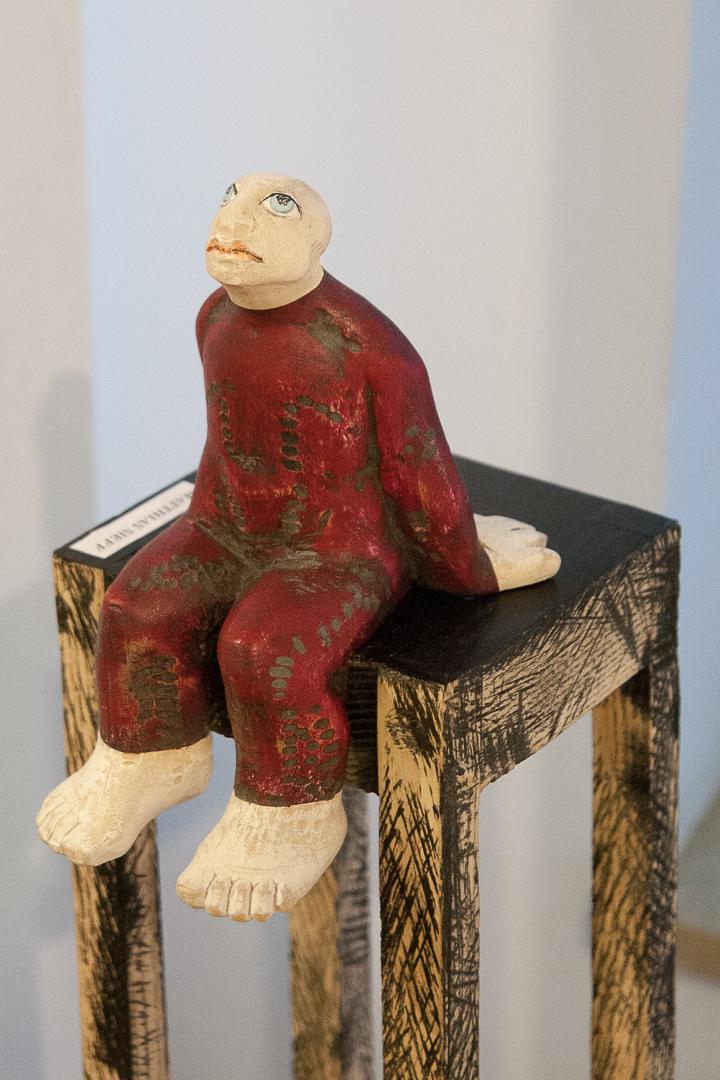 Figura seduta
